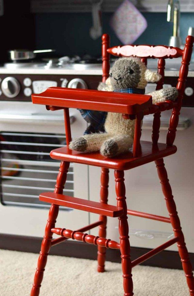 lamb in doll chair